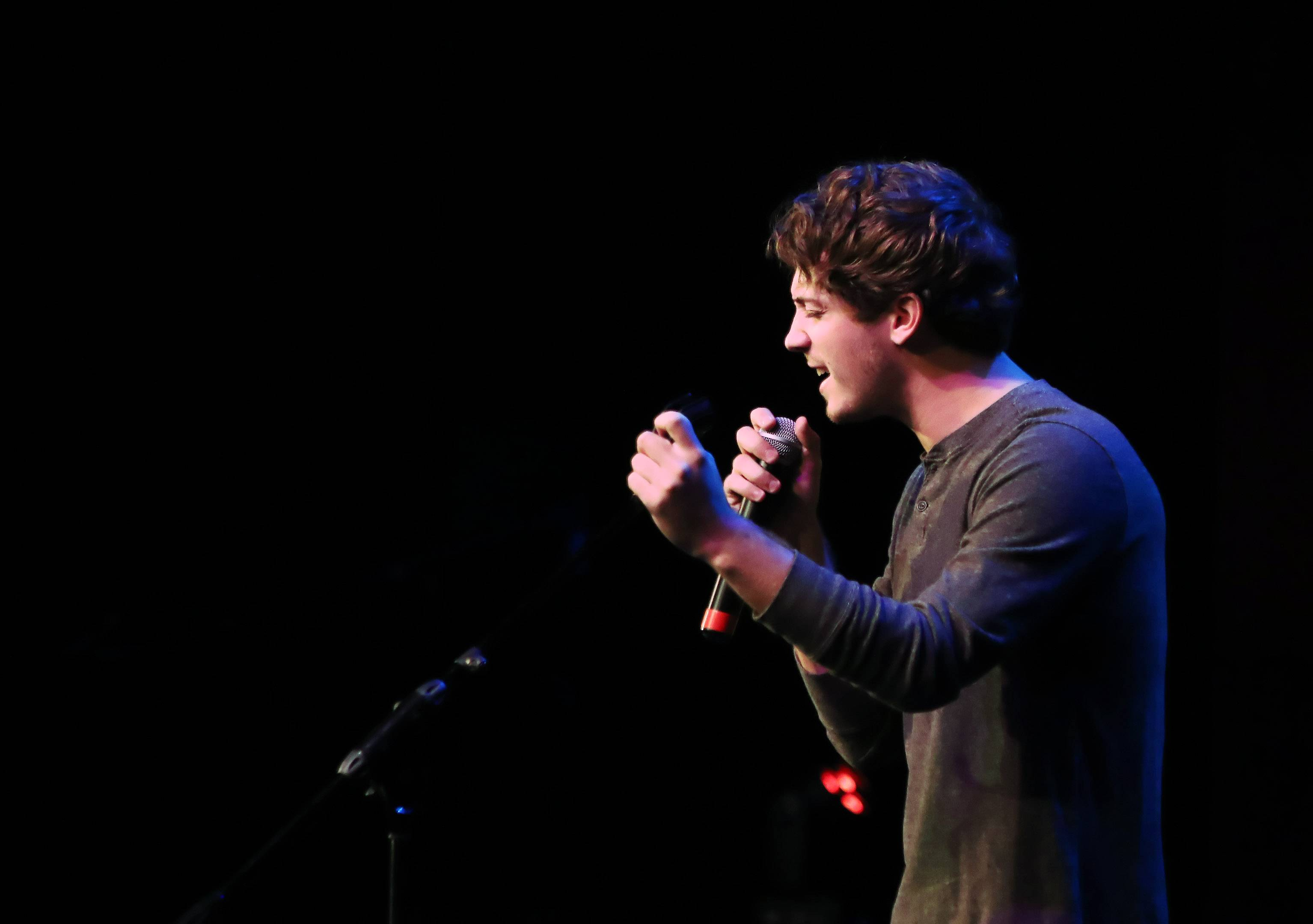 Garrett Ryan of West Dundee sings during the Suburban Chicago's Got Talent competition at the Prairie Center for the Arts in Schaumburg on Sunday night. The top 15 finalists performed as they competed for the grand prize to be announced of Aug. 5.
