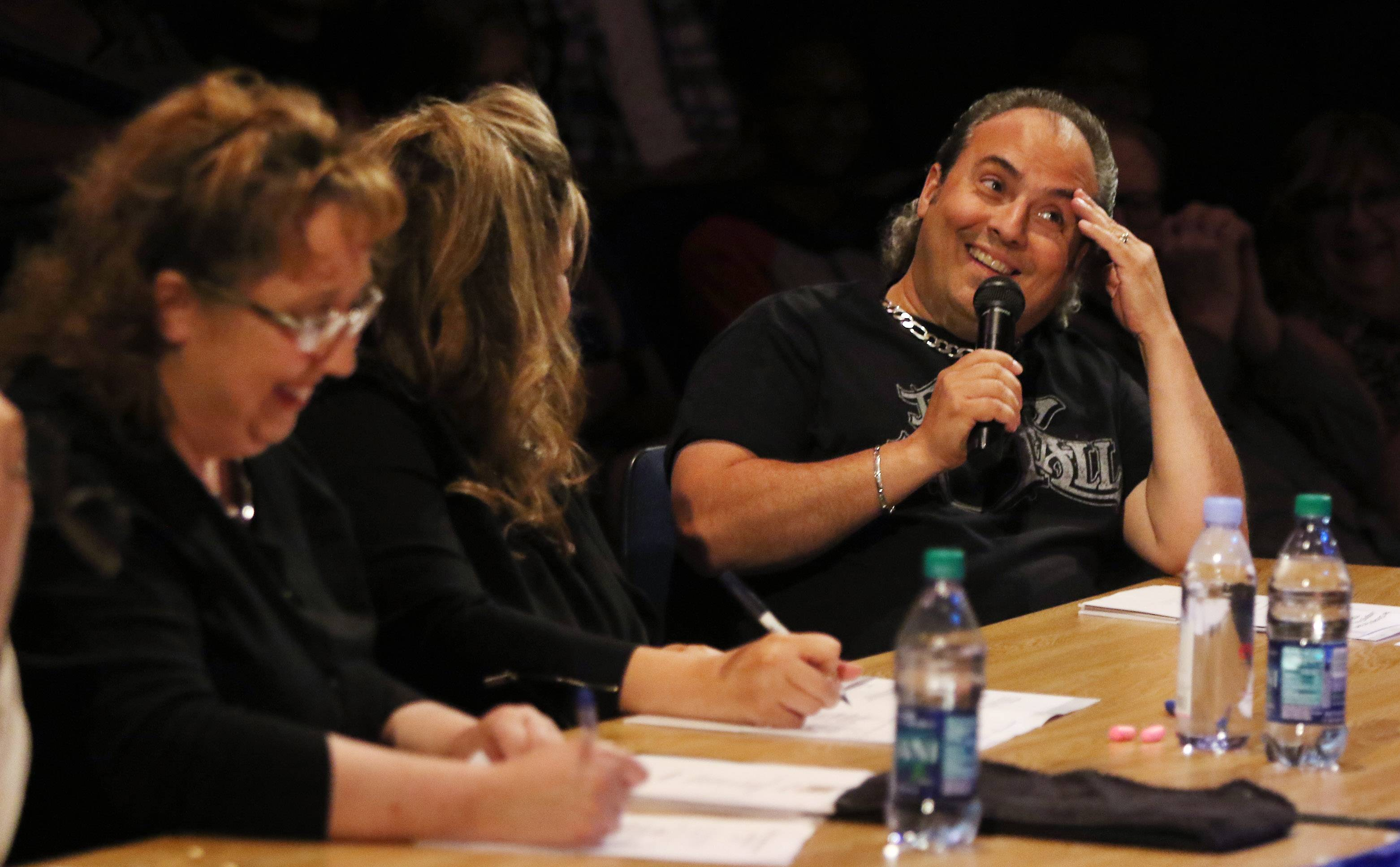 Judge Ron Onesti makes an observation as he talks about an act during the Suburban Chicago's Got Talent competition at the Prairie Center for the Arts in Schaumburg on Sunday night. The top 15 finalists performed as they competed for the grand prize to be announced of Aug. 5.