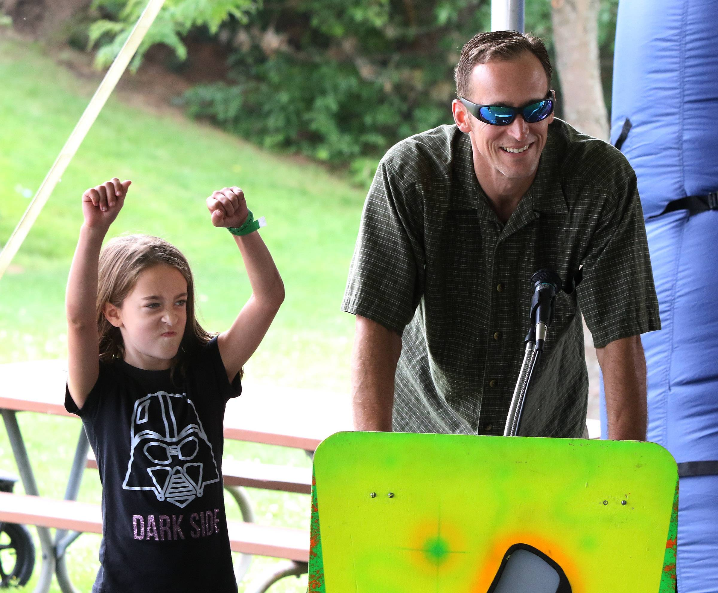 Morgan Straza, 8, of Vernon Hills celebrates with his father, Dave, after winning High Energy Trivia on Sunday, the last day of the Vernon Hills' Summer Celebration at Century Park.