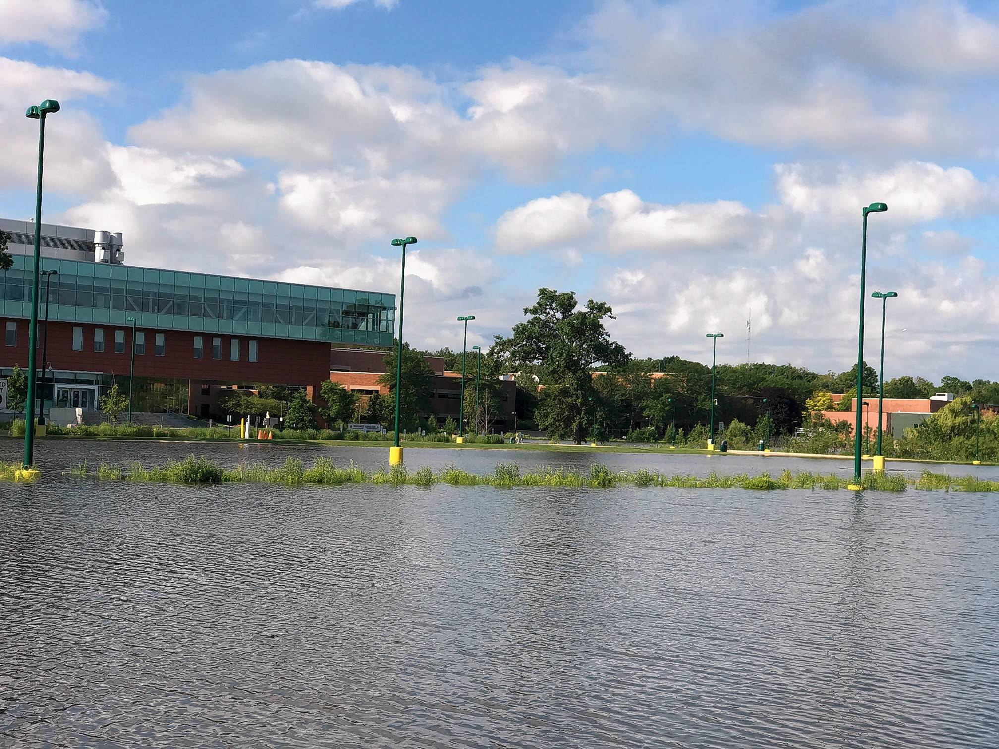 Although campus buildings remain dry, Oakton Community College will keep its Des Plaines campus closed for another day Monday because of flooded parking lots and nearby road closures.