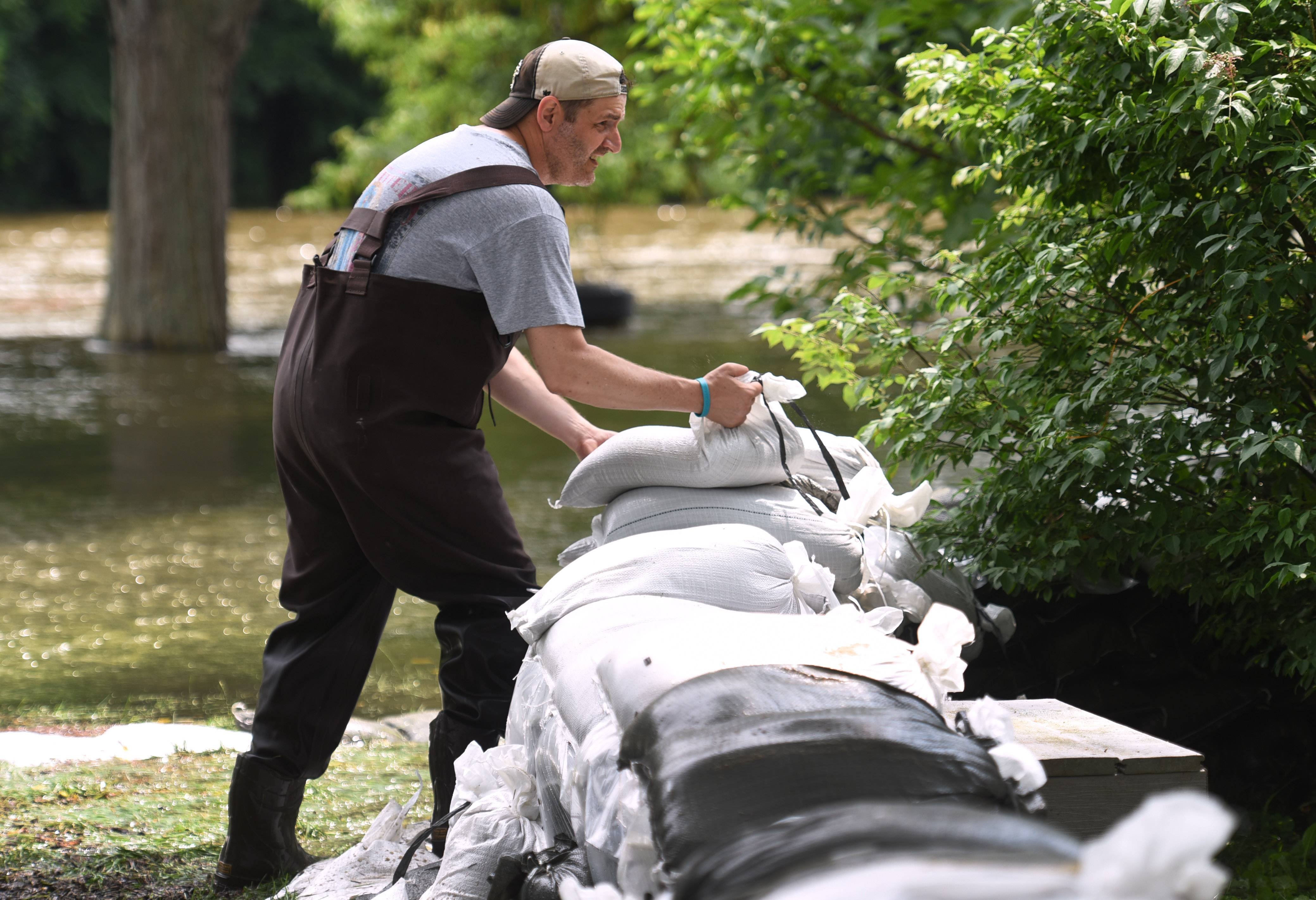Algonquin resident Dan Prokop sandbags along the Fox River behind his La Fox River Drive home Sunday. Prokop started the sandbagging process Thursday and makes adjustments as the river rises.