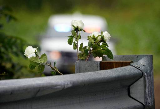 Flowers stand at the head of a driveway, Friday, July 14, 2017. in Solebury, Pa., as the investigation of four missing young Pennsylvania men continues. Lawyer Paul Lang, a defense attorney for Cosmo DiNardo, said Thursday that his client has admitted killing the four men who went missing last week and told authorities the location of the bodies. Lang says prosecutors agreed to take the death penalty off the table in return for DiNardo's cooperation.