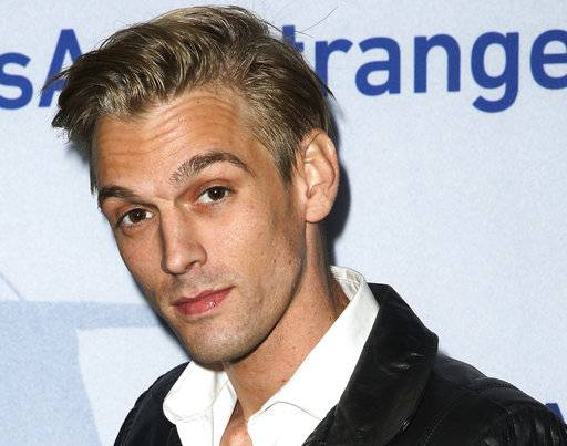 "FILE - In this Nov. 9, 2015, file photo, singer Aaron Carter arrives at a premiere of ""Saints & Strangers"" at the Saban Theater in Beverly Hills, Calif. Authorities said Carter and his girlfriend Madison Parker were arrested Saturday, July 15, 2017, on DUI and drug charges in Georgia. (Photo by Rich Fury/Invision/AP, File)"
