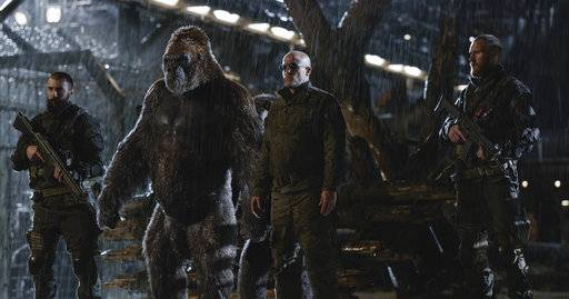 "FILE - This file image released by Twentieth Century Fox shows Woody Harrelson, center, in a scene from, ""War for the Planet of the Apes."" ""War for the Planet of the Apes� took down ""Spider-Man: Homecoming� at the North American box office, opening with an estimated $56.5 million in ticket sales, according to information available Sunday, July 16, 2017. (Twentieth Century Fox via AP, File)"