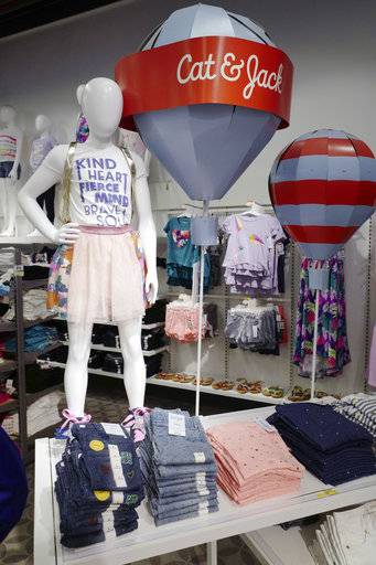 In this Friday, July 14, 2017, photo, Cat & Jack jeans and T-shirts appear on display at a Target store in New York. The clothes are made with Repreve polyester fabric, created from recycled plastic bottles.