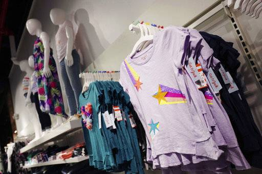 This Friday, July 14, 2017, photo shows Cat & Jack tops for girls made with Repreve polyester fabric created from recycled plastic bottles, on display at a Target store, in New York. For this year's back-to-school shopping season, green is the new black. Increasingly, parents and their kids are looking for second-hand clothing or fashions made from reused material.