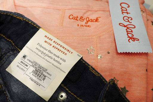 In this Friday, July 14, 2017, photo, a label in Cat & Jack jeans displayed at a Target store in New York indicates that they are made with 22 percent Repreve recycled polyester fabric. Target started offering fashions made of polyester created from recycled plastic bottles with last year's launch of its own Cat & Jack children's brand. The move came after seeing interest in eco-friendly products in its focus groups with parents and children.