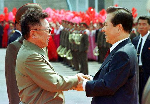 In this June 13, 2000, file photo, then North Korean leader Kim Jong Il, left, and then South Korean President Kim Dae-jung shake hands in Pyongyang. South Korea offered Monday, July 17, 2017, to talk with North Korea to ease animosities along their tense border and resume reunions of families separated by their war in the 1950s. (Yonhap/Pool Photo via AP, File)