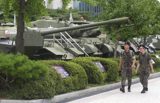 South Korean army soldiers pass by military vehicles deployed in the Korean War era at Korea War Memorial Museum in Seoul, South Korea, Monday, July 17, 2017. South Korea offered Monday to talk with North Korea to ease animosities along their tense border and resume reunions of families separated by their war in the 1950s.