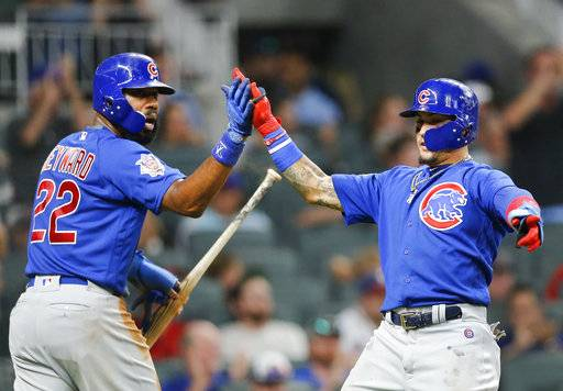 Chicago Cubs' Jason Heyward (22) and Javier Baez, right, celebrate after scoring on a single by Ben Zobrist during the fifth inning of a baseball game against the Atlanta Braves Monday, July 17, 2017, in Atlanta. Chicago won 4-3. (AP Photo/John Bazemore)