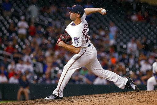 Minnesota Twins relief pitcher Brandon Kintzler throws to the New York Yankees during the ninth inning of a baseball game Monday, July 17, 2017, in Minneapolis. The Twins won 4-2. (AP Photo/Bruce Kluckhohn)