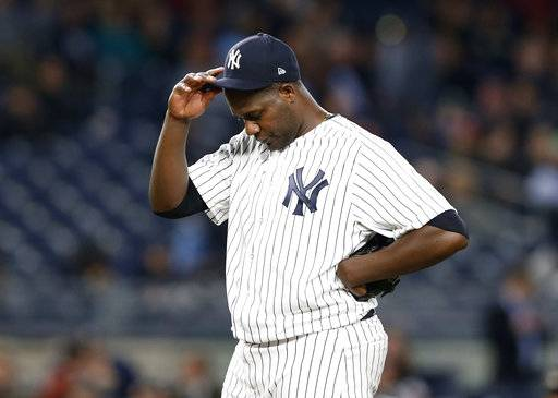 FILE - In this May 11, 2017, file photo, New York Yankees starting pitcher Michael Pineda pauses during the team's baseball game against the Houston Astros in New York. Pineda is set to have Tommy John surgery this week, likely putting him out of action until at least late next year. The Yankees said Pineda will have surgery Tuesday, July 18, to repair a torn ligament in his right elbow. (AP Photo/Kathy Willens, File)