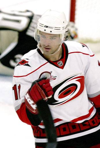 "FILE - In this Oct. 19, 2007, file photo, Carolina Hurricanes' Justin Williams celebrates scoring a goal against the Pittsburgh Penguins in the second period of tan NHL hockey game in Pittsburgh. The Carolina Hurricanes didn't bring back Justin Williams to be ""Mr. Game 7."" Not yet, anyway. The 35-year-old with the reputation for scoring big postseason goals is being asked to bring veteran leadership and a voice of experience to a young Carolina team. (AP Photo/Keith Srakocic, FIle)"