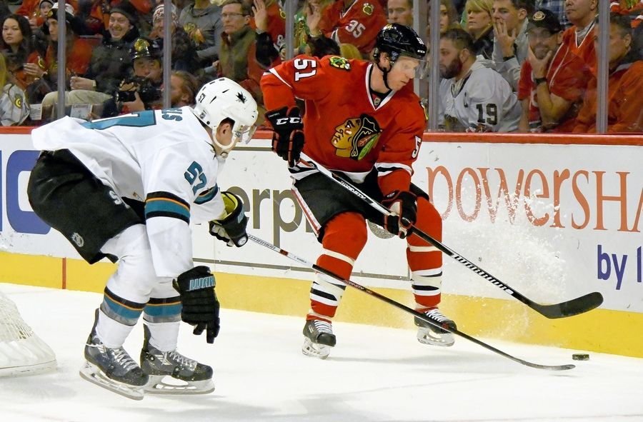 ddcc5b908 Chicago Blackhawks defenseman Brian Campbell (51) fights for a puck against  San Jose Sharks