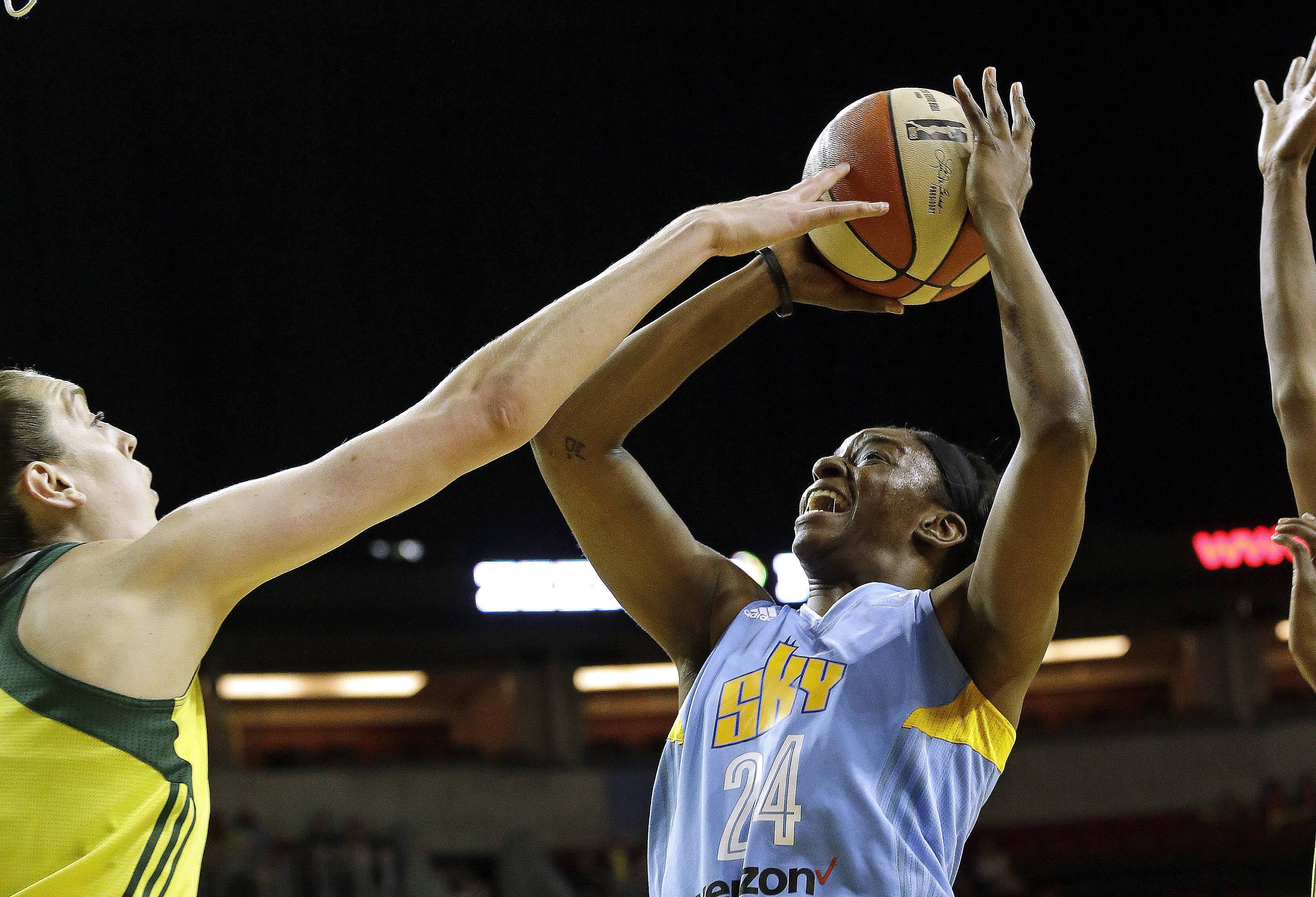 Seattle Storm's Breanna Stewart, left, tips away a shot by Chicago Sky's Keisha Hampton during the first half of a WNBA basketball game Tuesday, July 18, 2017, in Seattle.