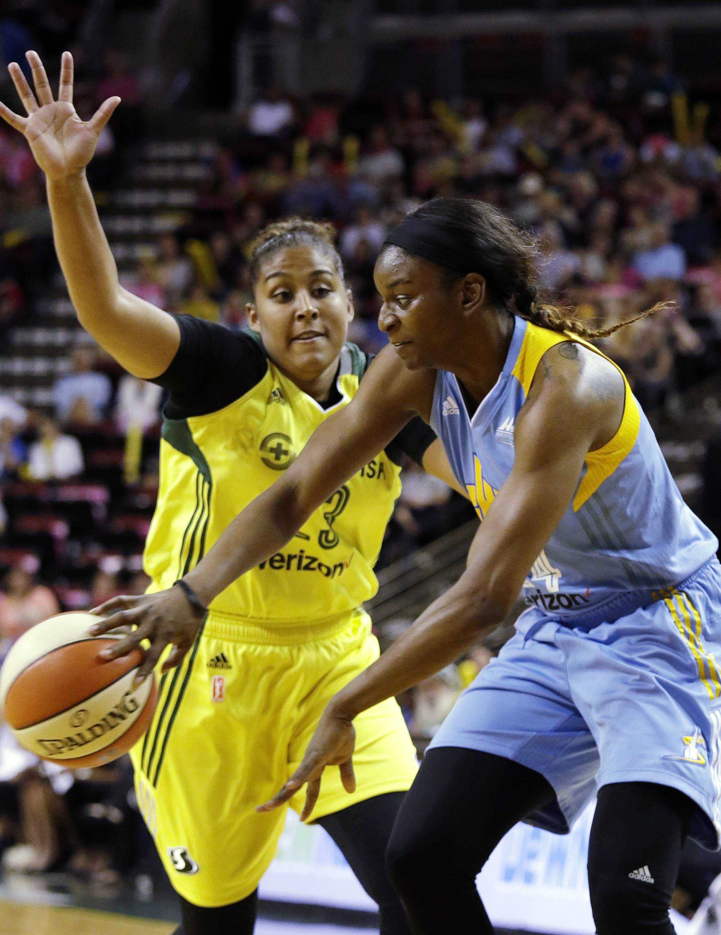 Chicago Sky's Keisha Hampton, right, passes the ball away from Seattle Storm's Kaleena Mosqueda-Lewis during the first half of a WNBA basketball game Tuesday, July 18, 2017, in Seattle.