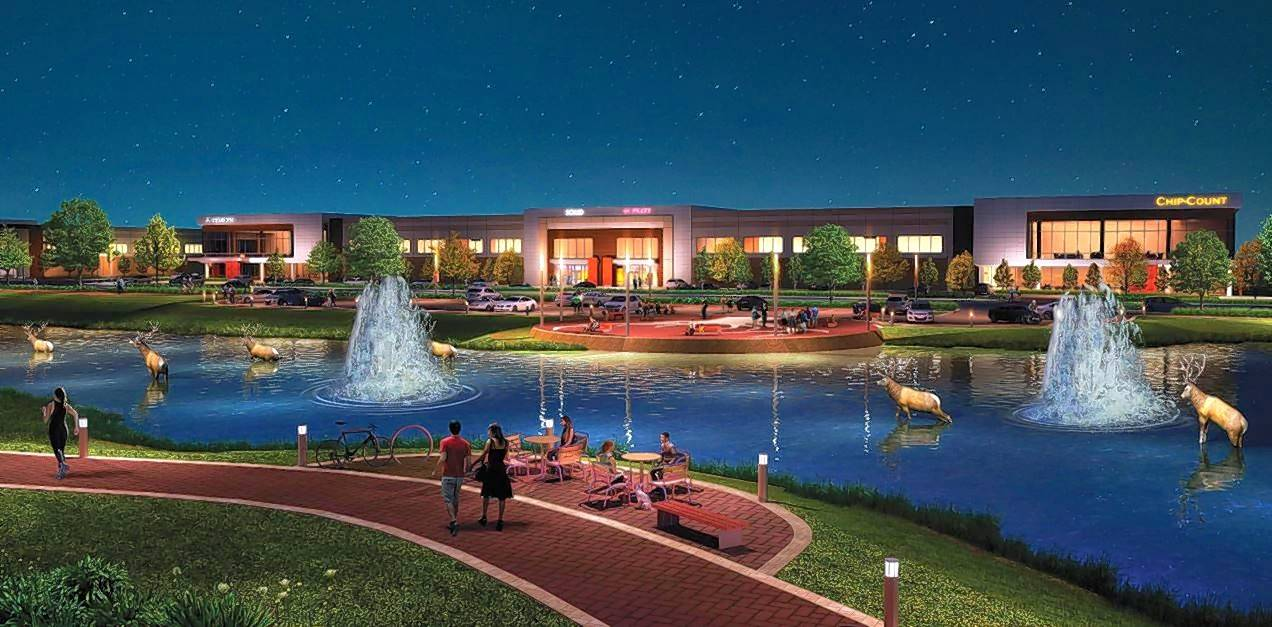 A conceptual drawing shows plans for pedestrian paths and water fountains in the Elk Grove Technology Park lighted up at night.