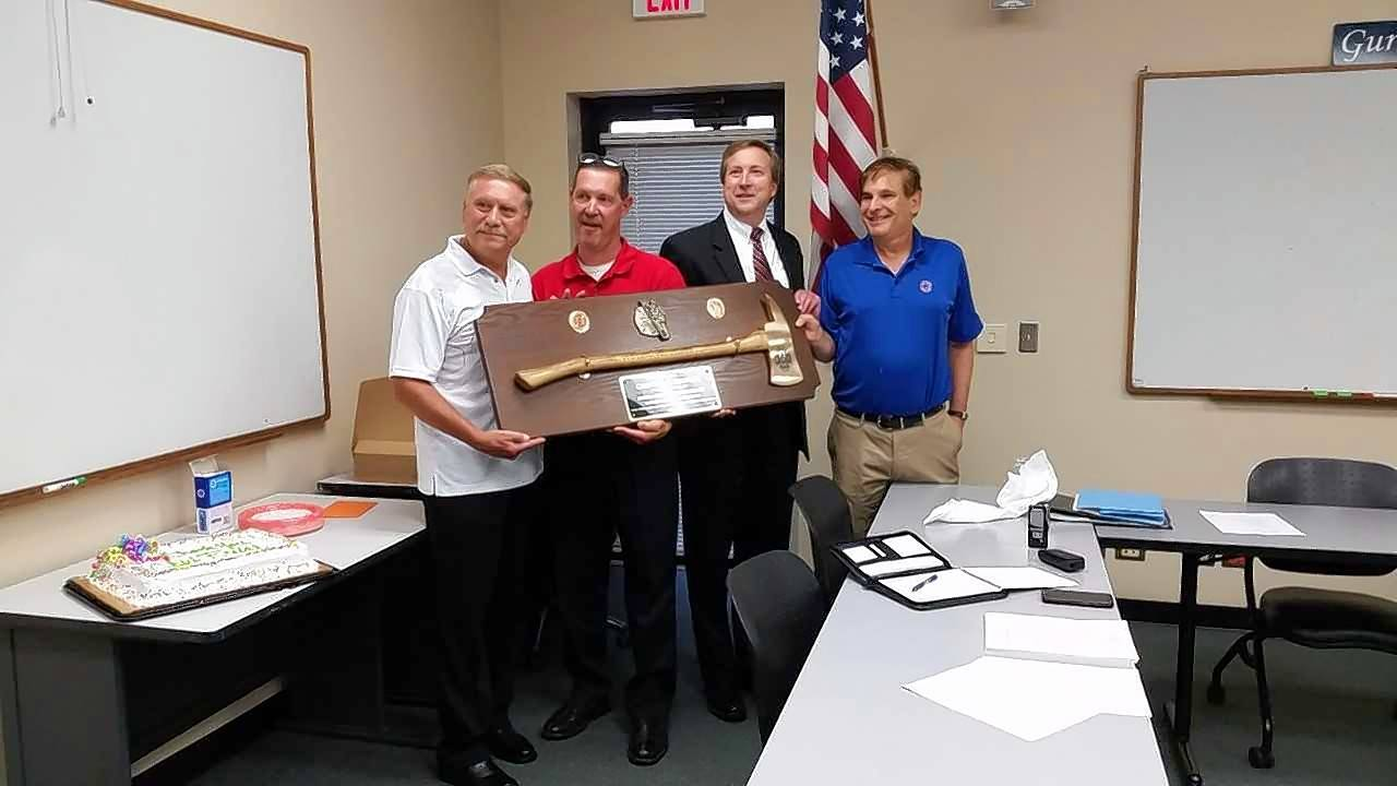 Former Gurnee Fire Chief Fred Friedl, far left, poses for a picture with the members of the Warren-Waukegan Fire Protection District board Wednesday night during a presentation honoring his long career. The board members are, from near left, Brian Wattleworth, Phillip DeRuntz and Marty Kauber.