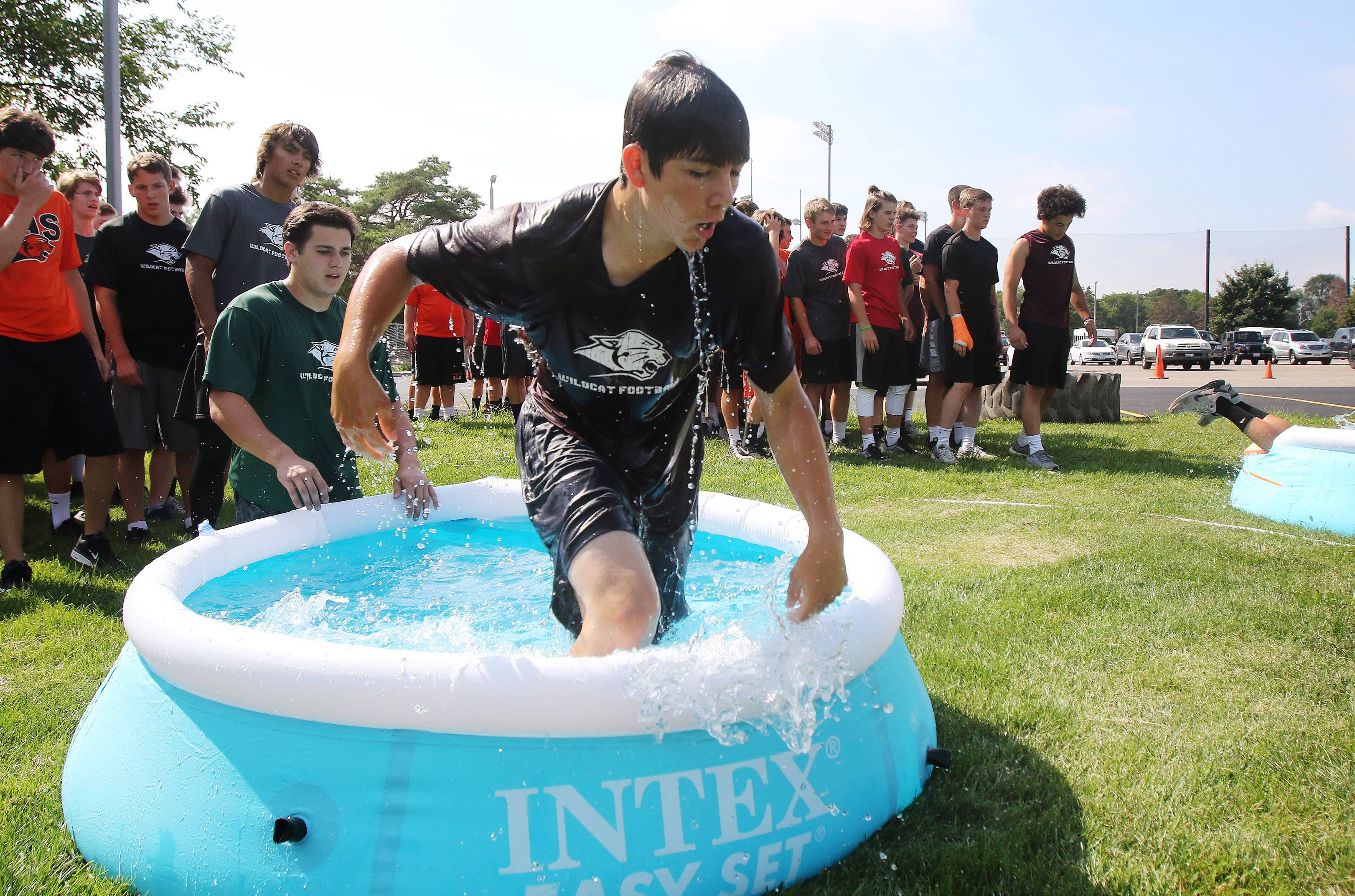 Libertyville High School football player Anthony Vincini comes out of a small swimming pool Wednesday during training led by a pair of retired U.S. Navy SEALs.