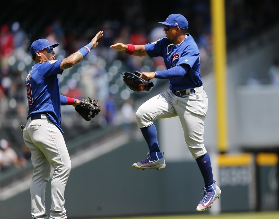 Chicago Cubs second baseman Javier Baez, left, and left fielder Jon Jay celebrate after defeating the Atlanta Braves 8-2 in a baseball game, Wednesday, July 19, 2017, in Atlanta.