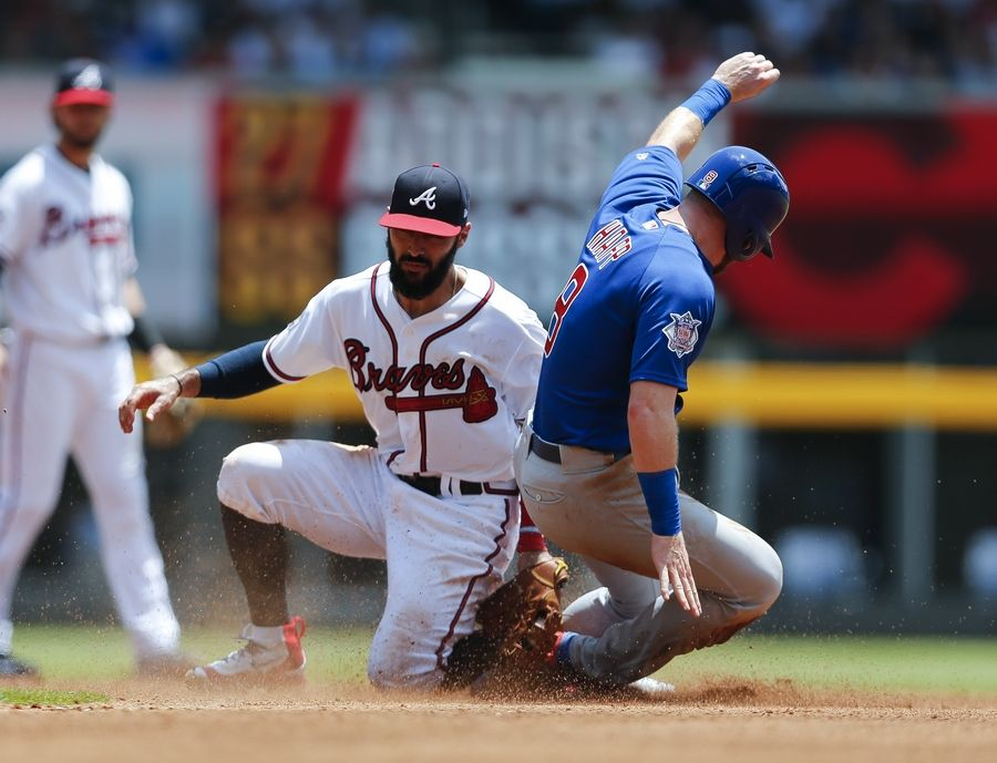 Chicago Cubs' Ian Happ (8) is tagged out by Atlanta Braves second baseman Sean Rodriguez (15) as he tries to steal second base in the fourth inning of a baseball game Wednesday, July 19, 2017, in Atlanta.