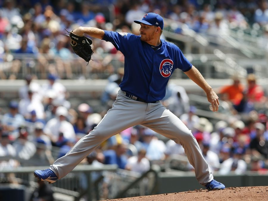 Chicago Cubs pitcher Mike Montgomery (38) works in the first inning of a baseball game against the Atlanta Braves Wednesday, July 19, 2017, in Atlanta.