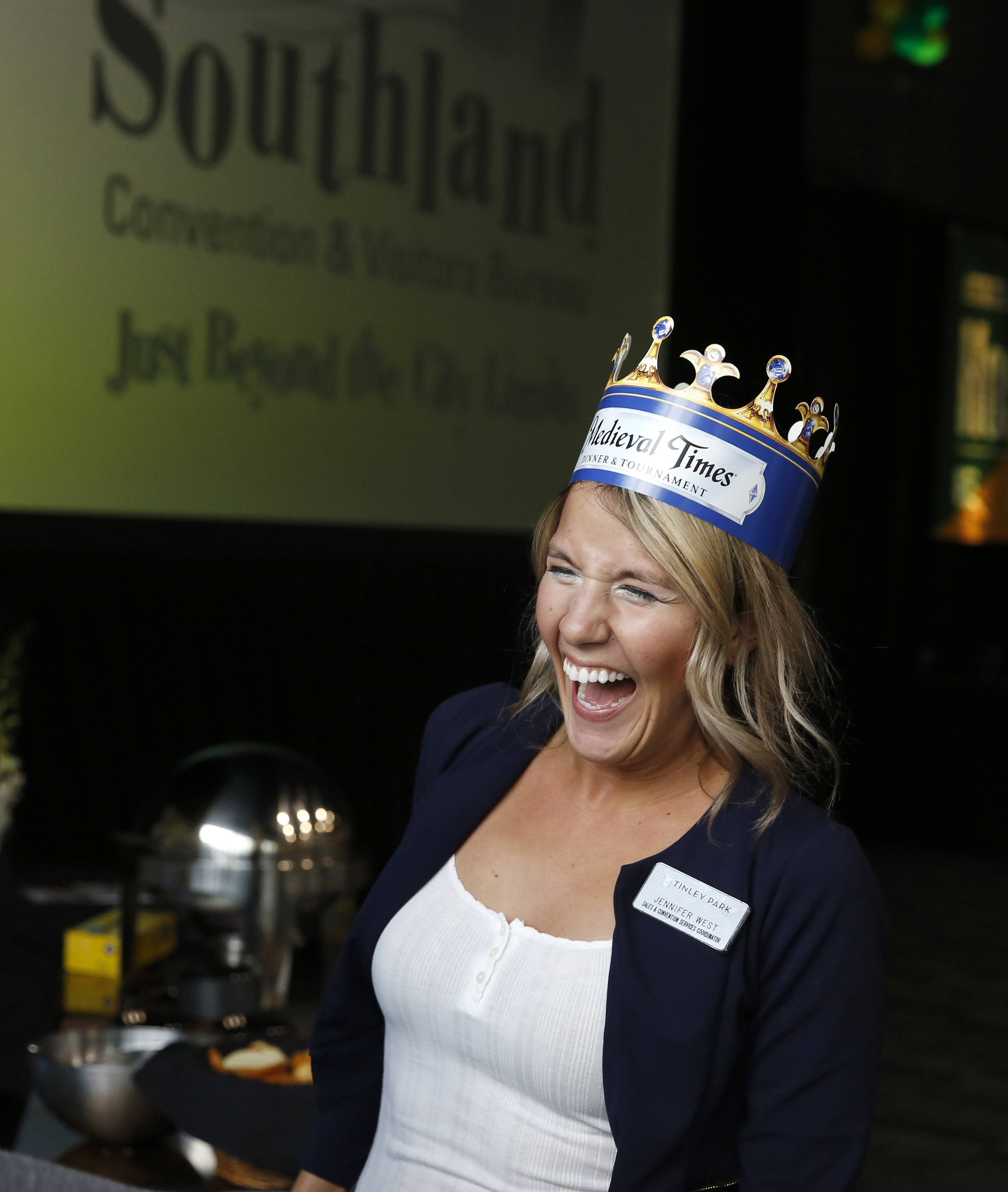 DanielWhite/dwhite@dailyherald.comJennifer West of the Tinley Park Convention Center models a Medieval Times crown during the BizLedger Hospitality Expo.