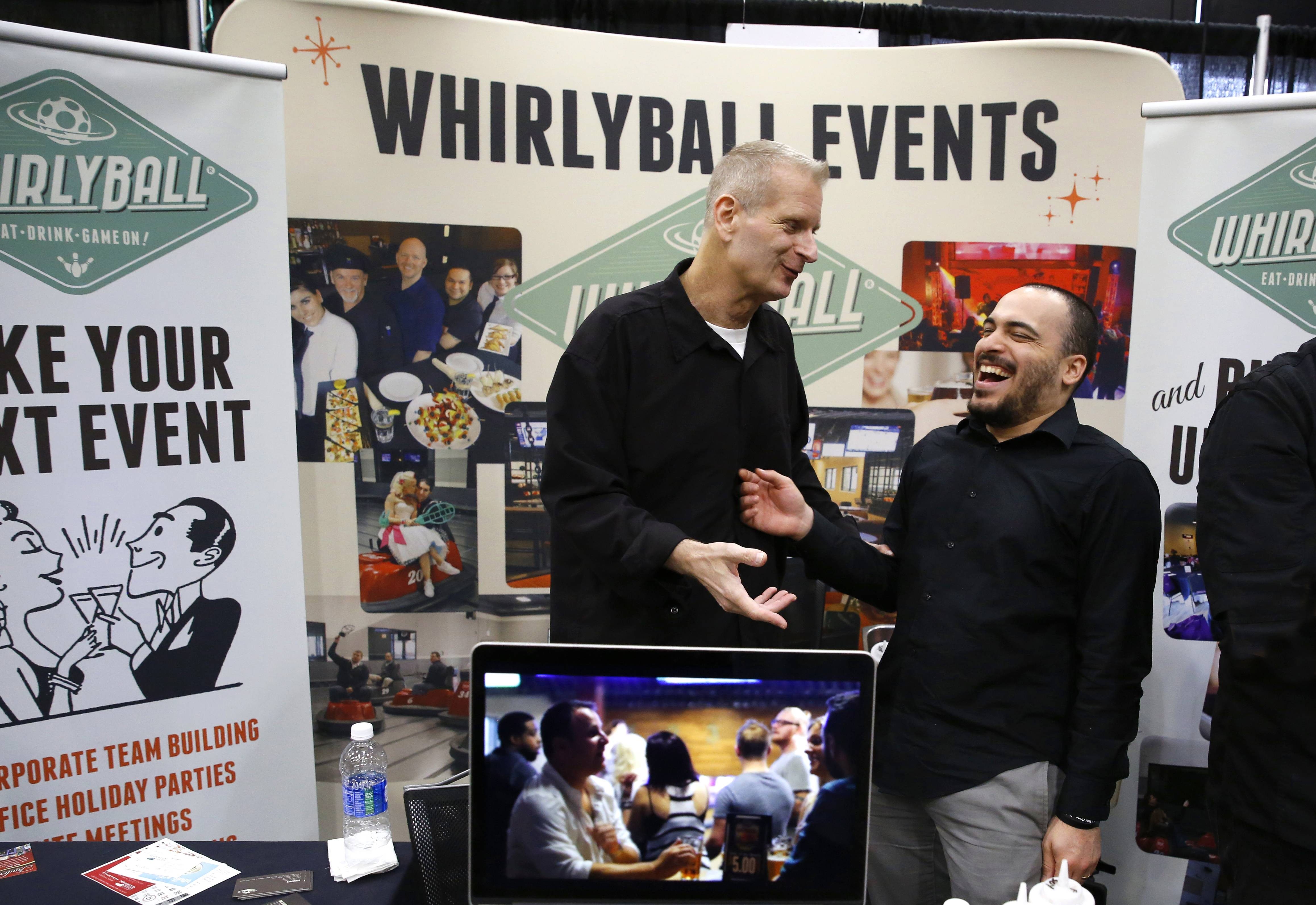DanielWhite/dwhite@dailyherald.comJohn Krol, left, and Joel Alvarado, right, of Whirlyball maintained a booth during the BizLedger Hospitality Expo at the Tinley Park Convention Center.