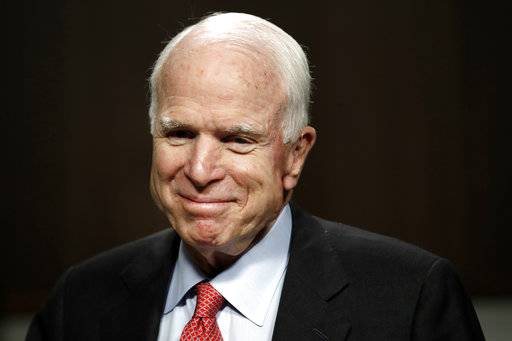 FILE - In this July 11, 2017, file photo, Sen. John McCain, R-Ariz., arrives on Capitol Hill in Washington. McCain has been diagnosed with a brain tumor after a blood clot was removed. (AP Photo/Jacquelyn Martin, File)