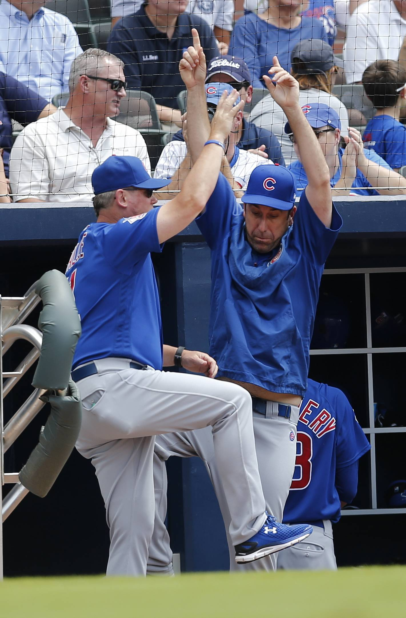 Chicago Cubs hitting coach John Mallee (11), left, and catching coach Mike Borzello (58) react after a Cubs' run in the second inning of a baseball game against the Atlanta Braves Wednesday, July 19, 2017, in Atlanta. (AP Photo/John Bazemore)