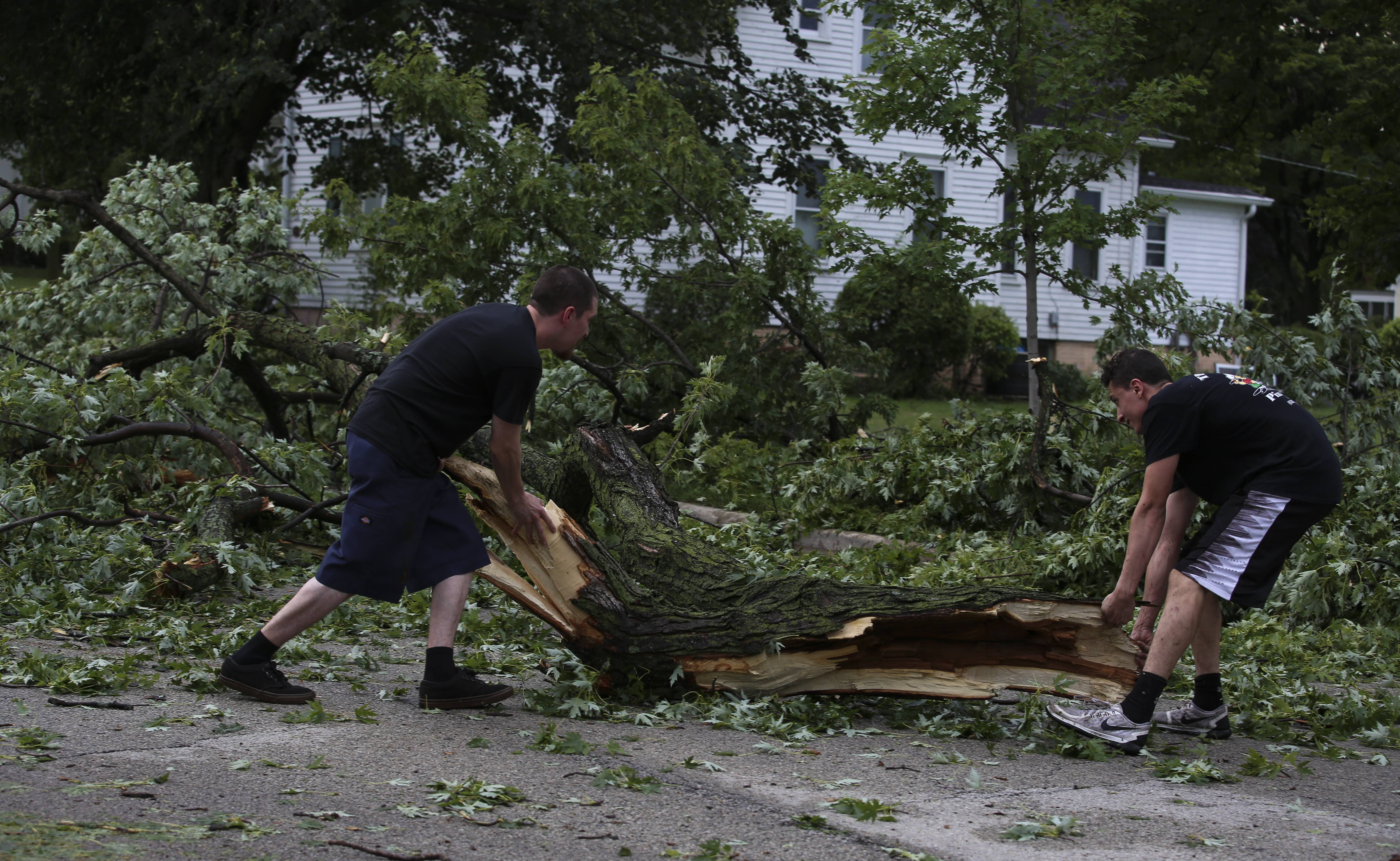 Storms rake suburbs, down power lines