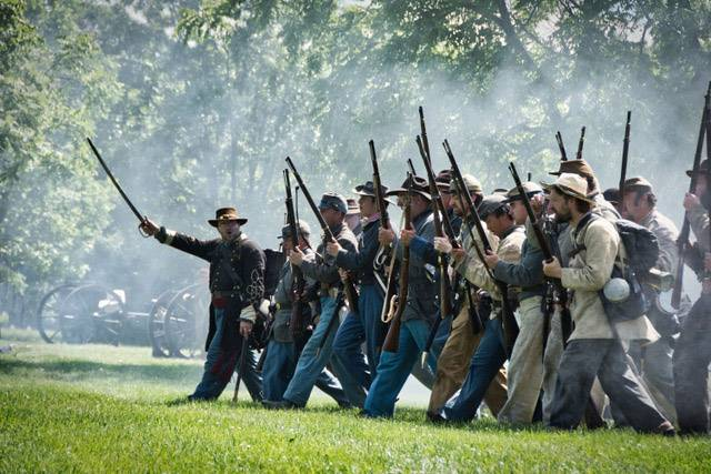 The start of the Confederate army charge during the mock battle at the Civil War re-enactment in the Lakewood Forest Preserve near Wauconda on Saturday, July 8.