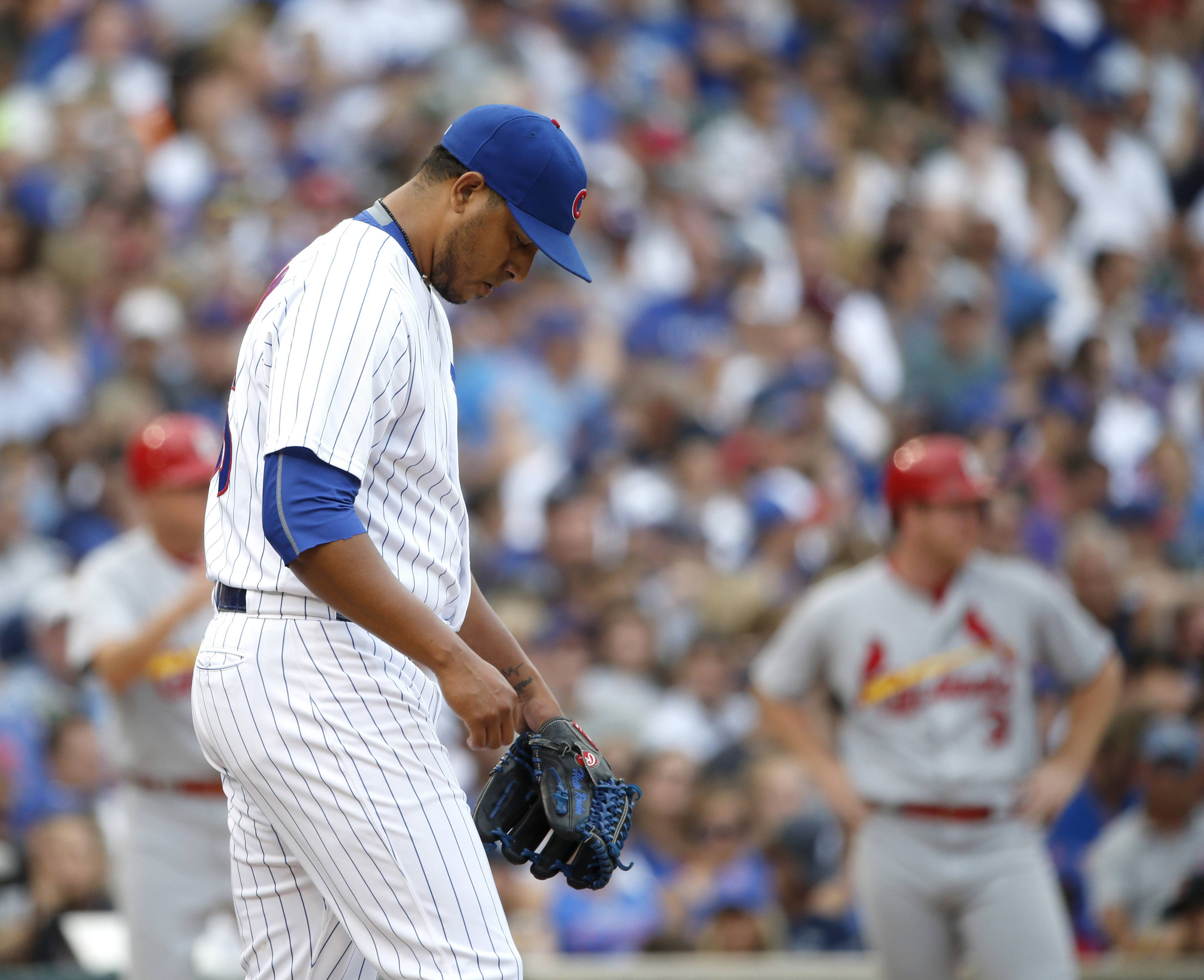 Chicago Cubs relief pitcher Hector Rondon returns to the mound after walking in a run during the eighth inning against the St. Louis Cardinals on in Chicago. The Cardinals scored 9 runs that inning.