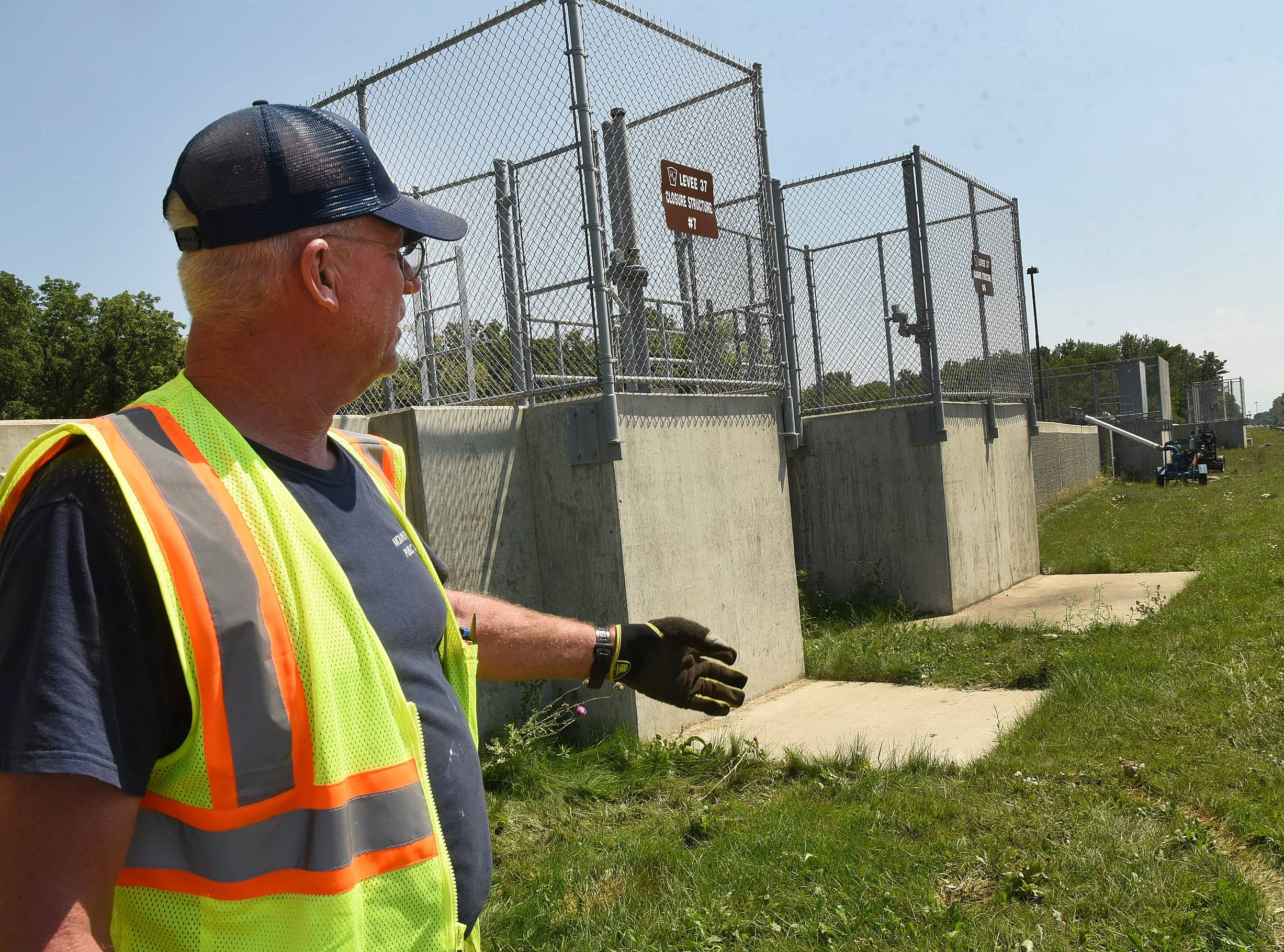 Steve Balogh of the Mount Prospect public works department helps oversee Levee 37 along River Road. The flood wall, finished in 2015, helped keep neighborhoods dry during recent storms.
