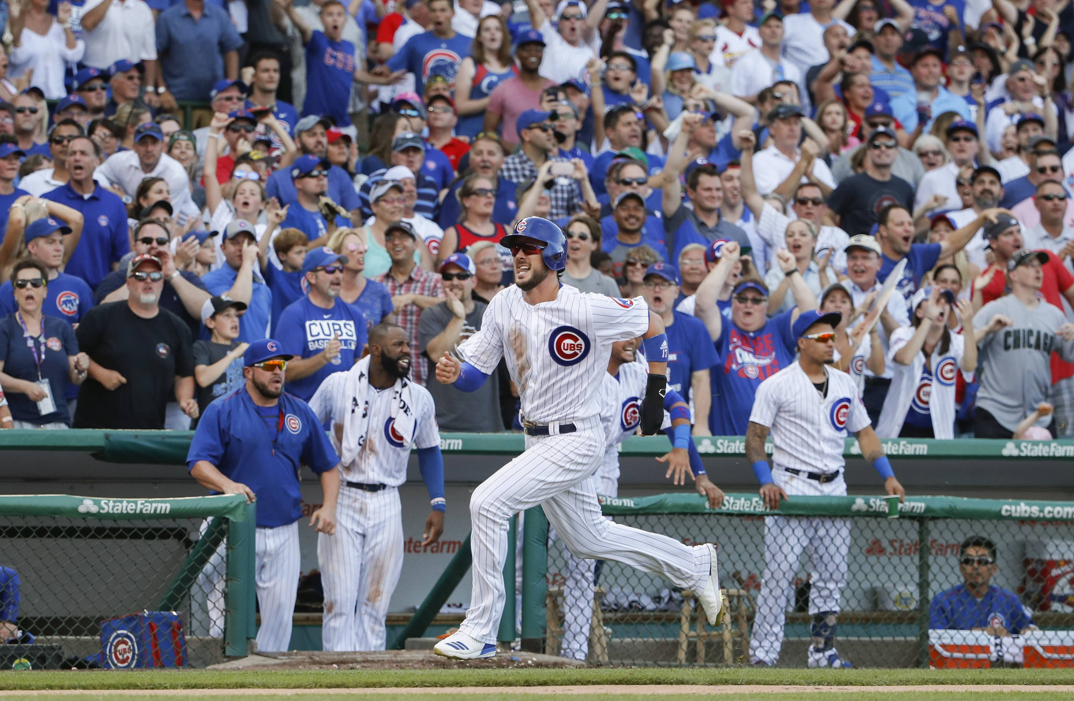 Chicago Cubs' Jason Heyward runs the bases after hitting a triple off St. Louis Cardinals starting pitcher Adam Wainwright during the second inning of a baseball game, Saturday, July 22, 2017, in Chicago. (AP Photo/Kamil Krzaczynski)