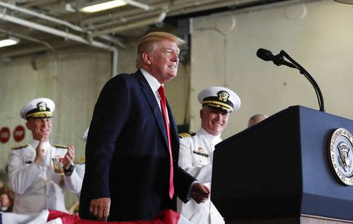 President Donald Trump waves as he boards Air Force One, Saturday, July 22, 2017, in Andrews Air Force Base, Md., en route to Naval Air Station Norfolk, in Norfolk, Va., to attend the commissioning ceremony of the aircraft carrier USS Gerald R. Ford (CVN 78). (AP Photo/Carolyn Kaster)