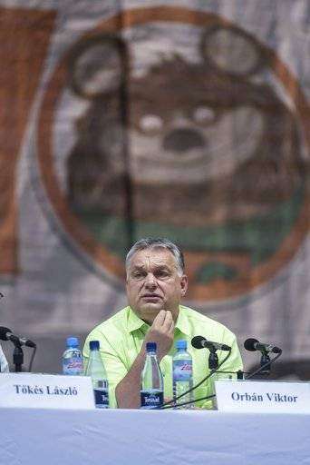 Hungarian Prime Minister Viktor Orban delivers his speach at the 28th Balvanyos Summer University and Students' Camp in Baile Tusnad, Transylvania, Romania, Saturday, July 22, 2017. (Nandor Veres/MTI via AP)