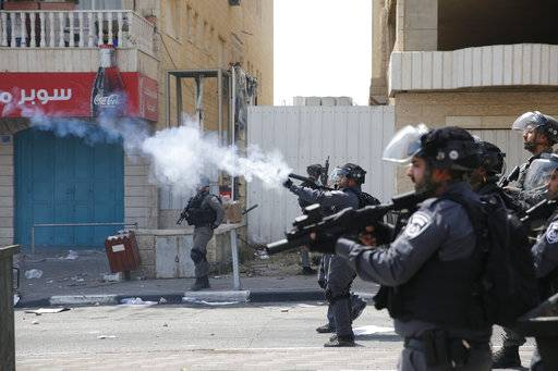 Israeli border border police fire tear gas at Palestinians during clashes in the West Bank city of Bethlehem, Friday, July 21, 2017. Israel police severely restricted Muslim access to a contested shrine in Jerusalem's Old City on Friday to prevent protests over the installation of metal detectors at the holy site.(AP Photo/Nasser Shiyoukhi)
