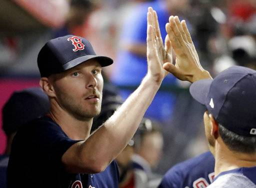 Boston Red Sox starting pitcher Chris Sale is greeted in the dugout after sixth inning of the team's baseball game against the Los Angeles Angels in Anaheim, Calif., Friday, July 21, 2017. (AP Photo/Chris Carlson)