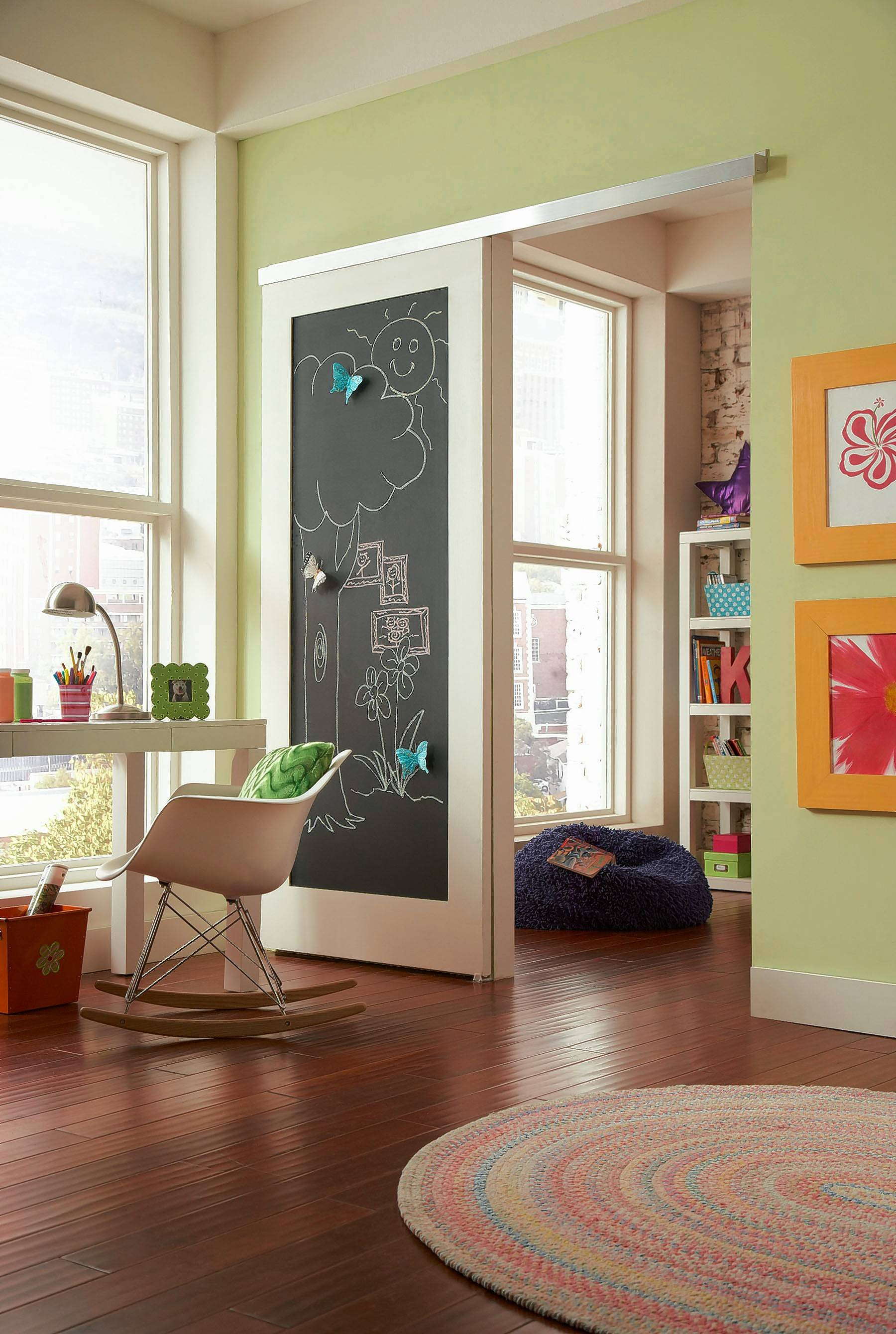 Sliding barn doors can add a fun blackboard wall space for playrooms. & Barn doors add style to space Pezcame.Com