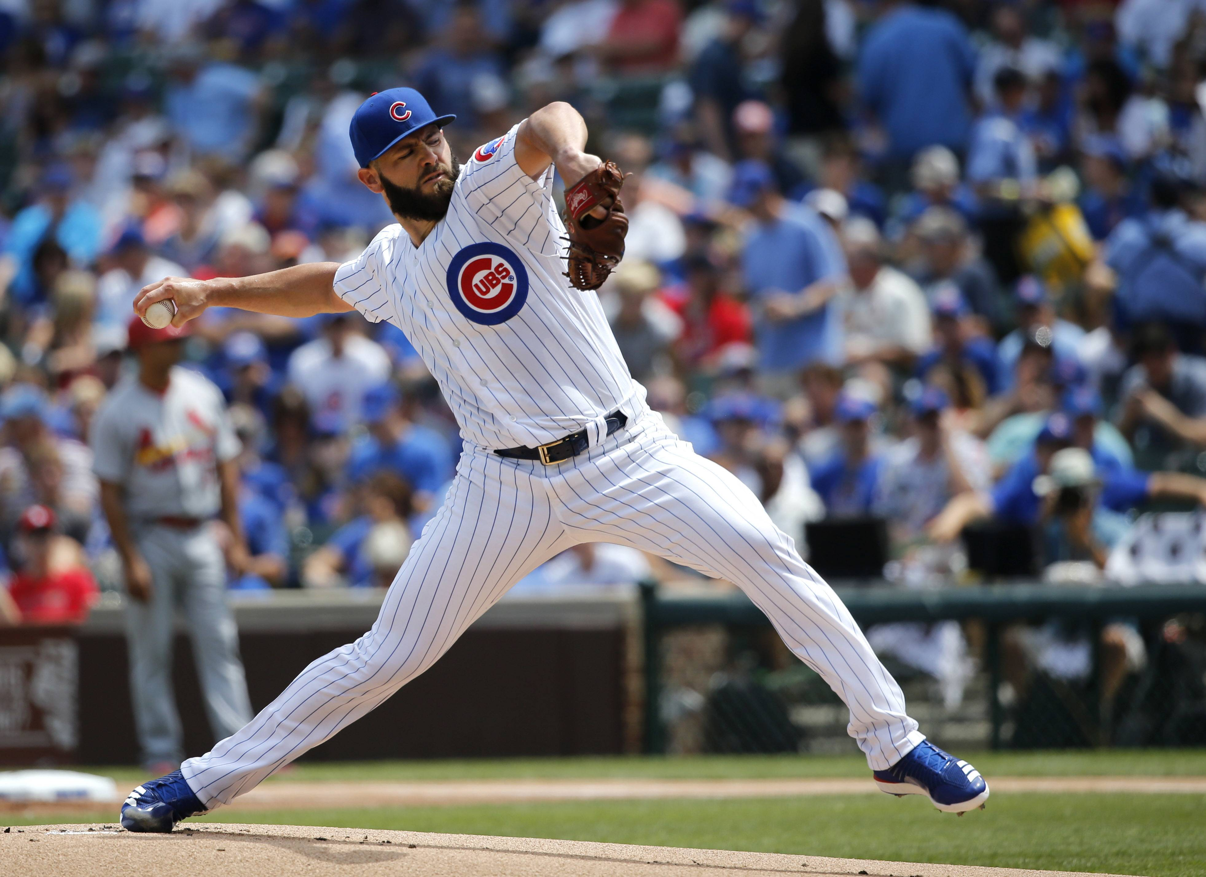 Chicago Cubs starting pitcher Jake Arrieta delivers during the first inning of a baseball game against the St. Louis Cardinals Friday, July 21, 2017, in Chicago. A huge part of the Cubs' rebuild was getting Arrieta and Pedro Strop in a trade with the Baltimore Orioles. (AP Photo/Charles Rex Arbogast)