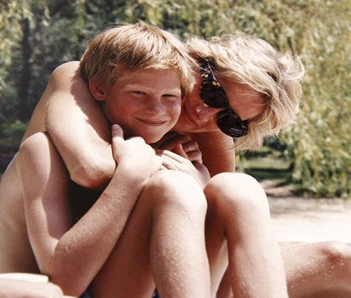"In this photo made available by Kensington Palace from the personal photo album of the late Diana, Princess of Wales, shows the princess and Prince Harry on holiday, and features in the new ITV documentary 'Diana, Our Mother: Her Life and Legacy.' Prince William and Prince Harry will pay tribute to their mother, Princess Diana, as the 20th anniversary of her death in a car crash approaches in a TV documentary ""Diana, Our Mother: Her Life and Legacy� which will air Monday July 24, 2017 on British TV. (The Duke of Cambridge and Prince Harry/Kensington Palace via AP) NO USE ON THE FRONT COVERS OF ANY UK OR INTERNATIONAL MAGAZINES. NO COMMERCIAL USE (including any use in merchandising, advertising or any other non-editorial use including, for example, calendars, books and supplements)."