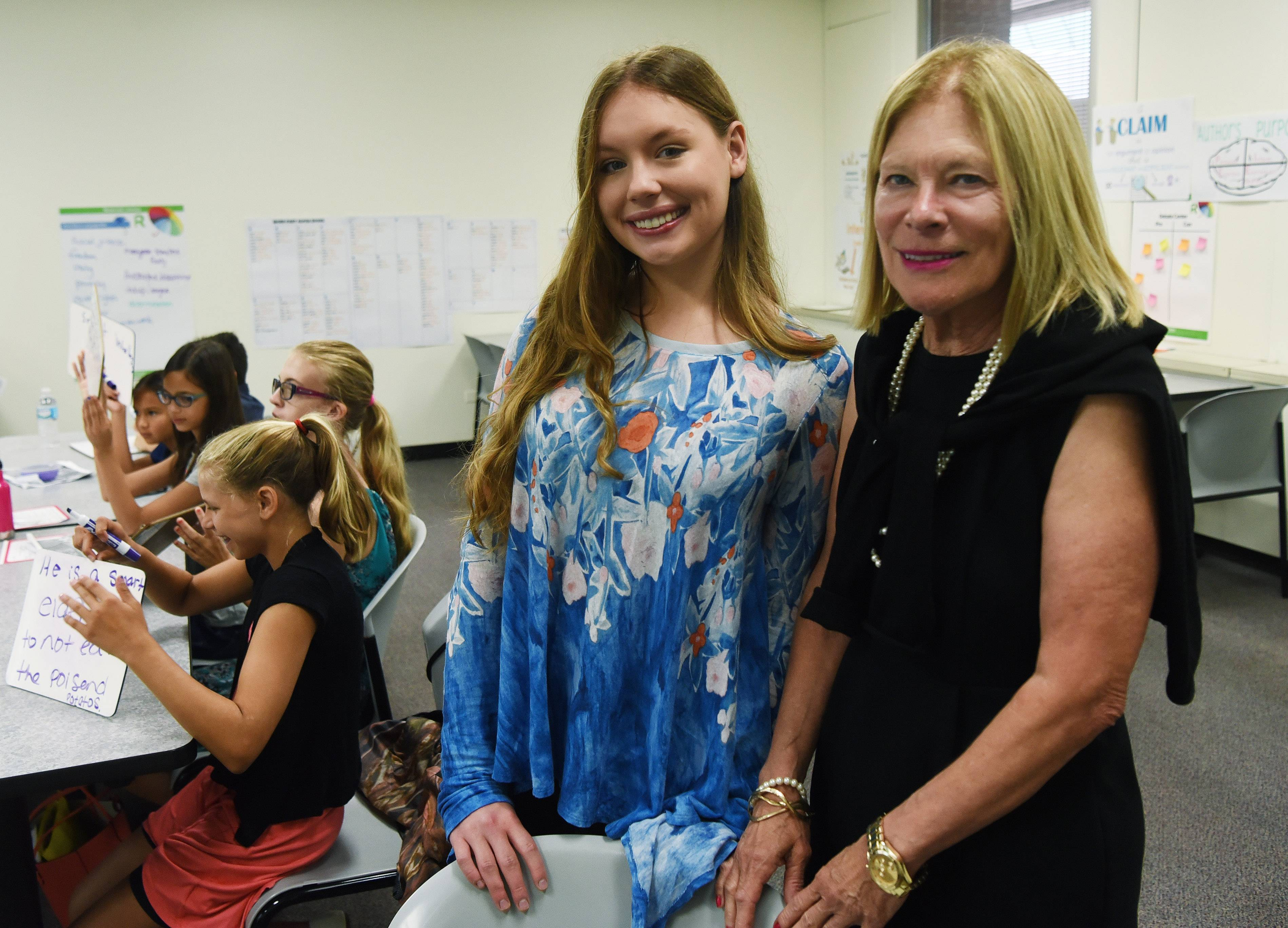 Margaret Policastro, founder and director of Roosevelt University's Schaumburg summer reading clinic, and 18-year-old volunteer and former student Karen Iverson are working together at this summer's session for area youngsters. The program is celebrating its 30th year.