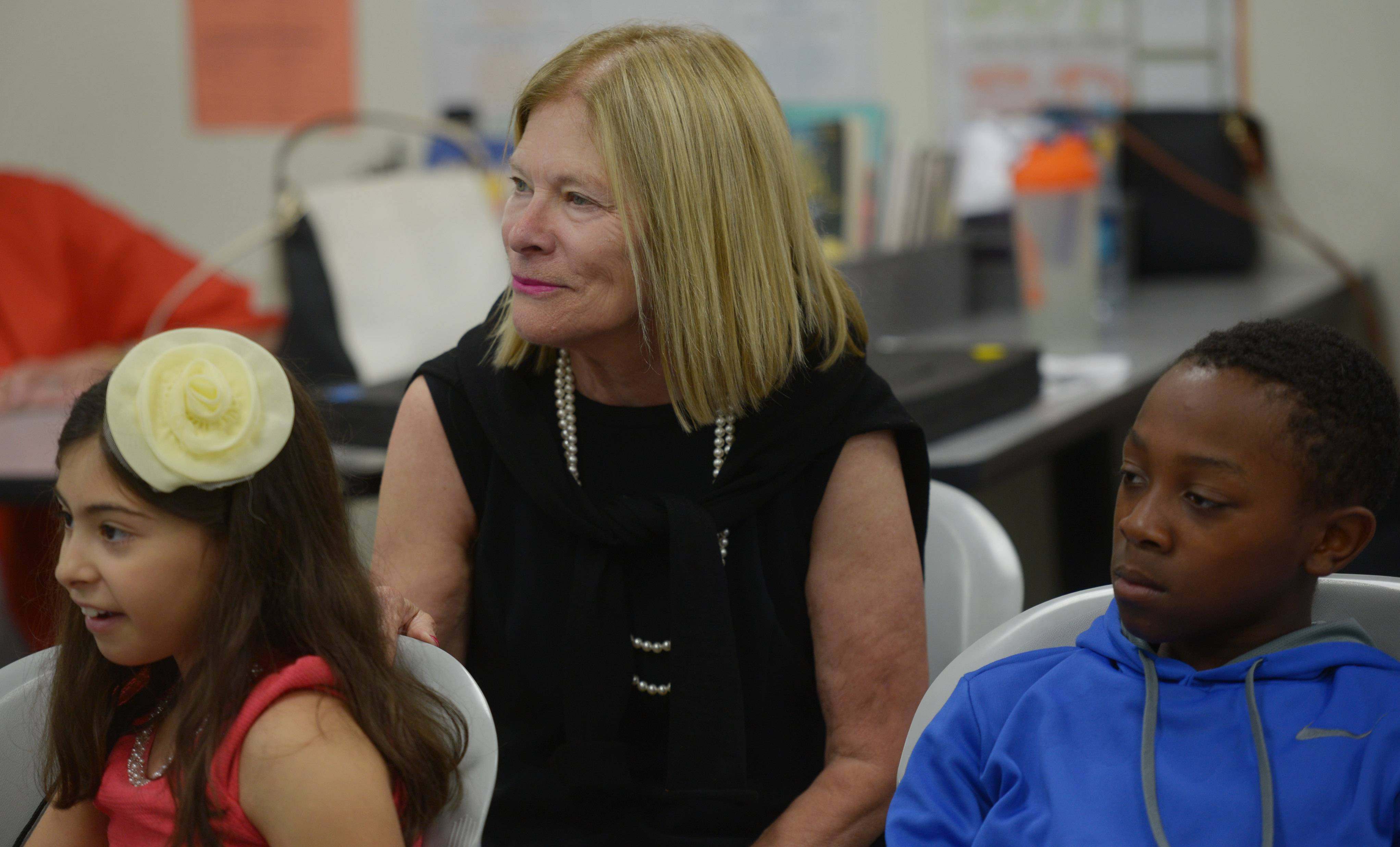 Margaret Policastro, founder and director of Roosevelt University's Schaumburg summer reading clinic for area youngsters, observes a lesson while seated with students Christina Sourounis, 8, left, and Micah Rienstra-Kracofe. The reading program celebrates its 30th year this year.