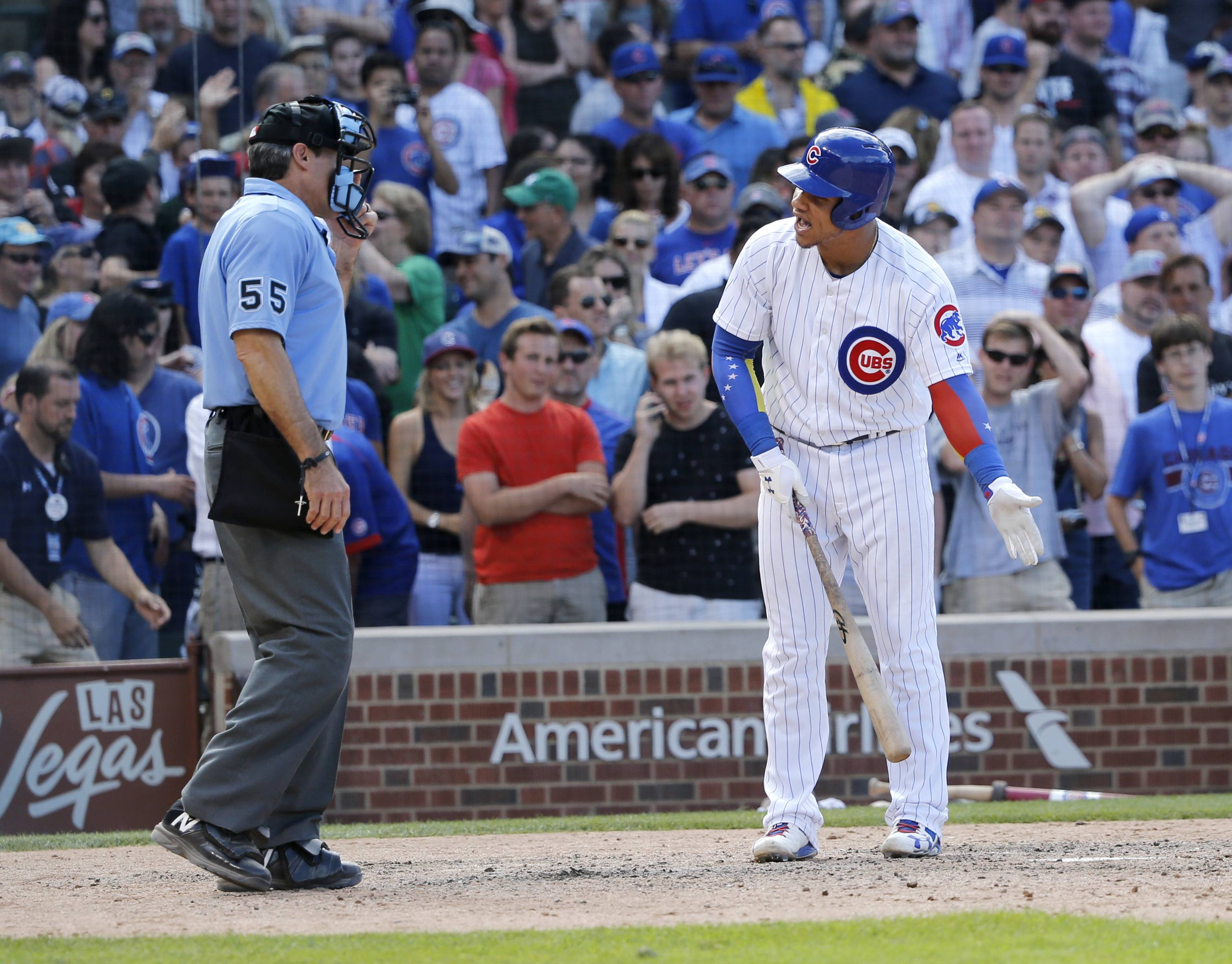 Chicago Cubs' Willson Contreras, right, argues with home plate umpire Angel Hernandez after Hernandez called him out on strikes to end a baseball game against the Chicago White Sox, Monday, July 24, 2017, in Chicago.