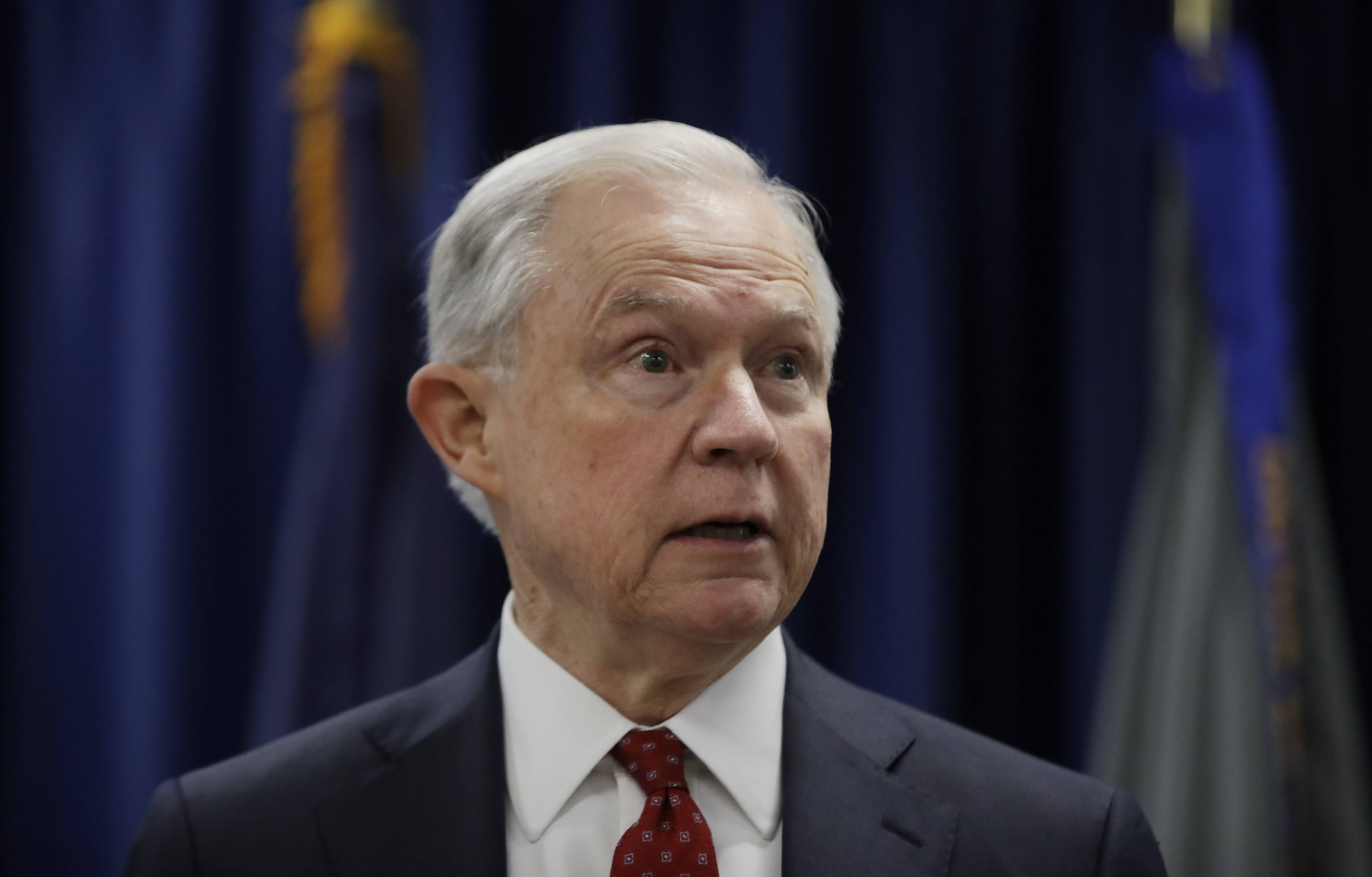 "Attorney General Jeff Sessions speaks in Philadelphia. President Donald Trump took a new swipe at Sessions on Monday, referring to him in a tweet as ""beleaguered"" and wondering why Sessions isn't digging into Hillary Clinton's alleged contacts with Russia."