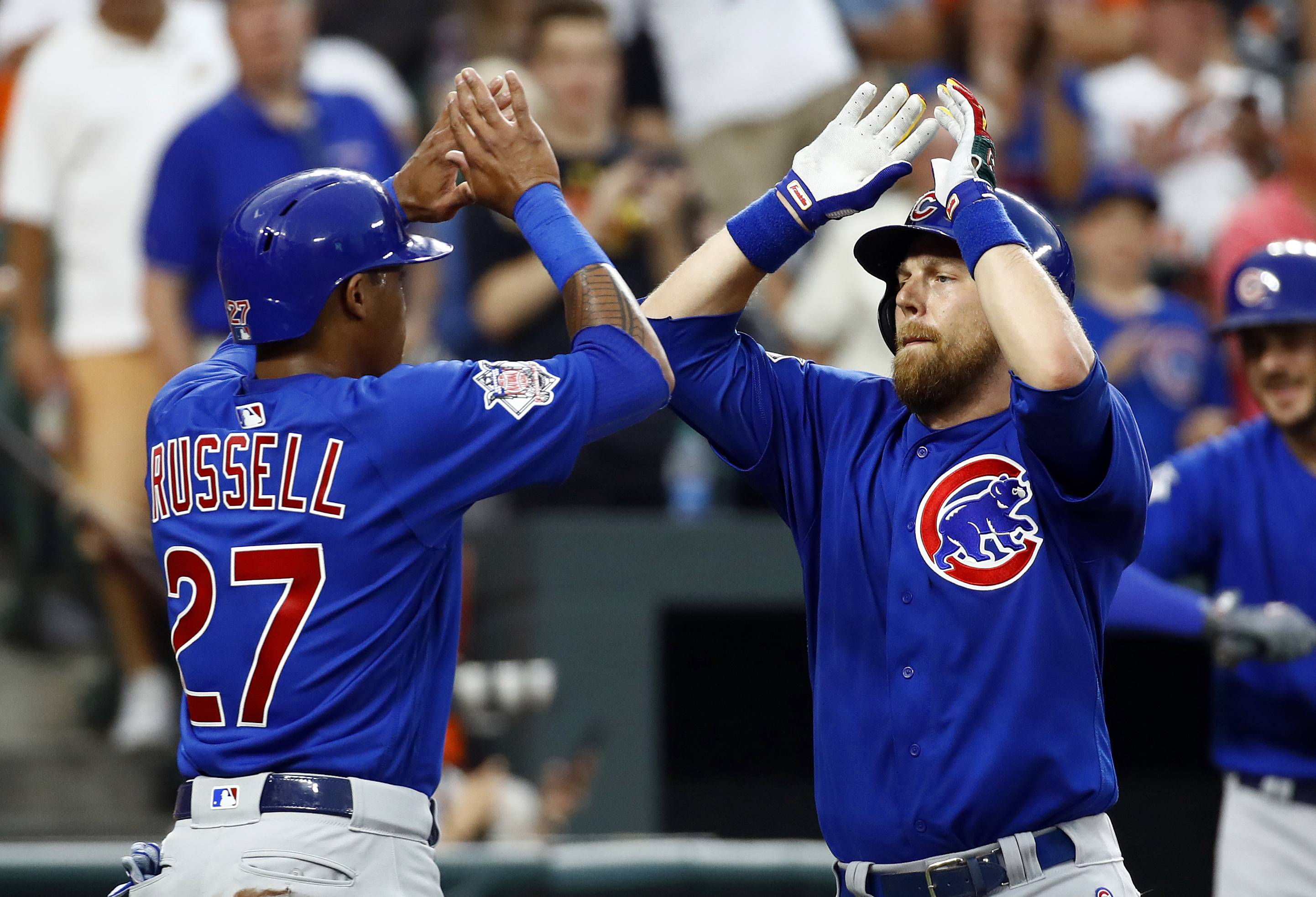 Ben Zobrist, right, will hit in the No. 1 slot, and teammate Addison Russell will return to the starting lineup and bat eighth as the Cubs load up with right-handed hitters in Game 2 of the Crosstown Cup series today with the White Sox and lefty pitcher Carlos Rodon.