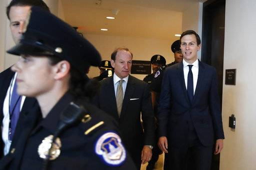 White House adviser Jared Kushner, right, and his attorney Abbe Lowell, center, arrive on Capitol Hill in Washington, Tuesday, July 25, 2017, to be interviewed behind closed doors by the House Intelligence Committee.