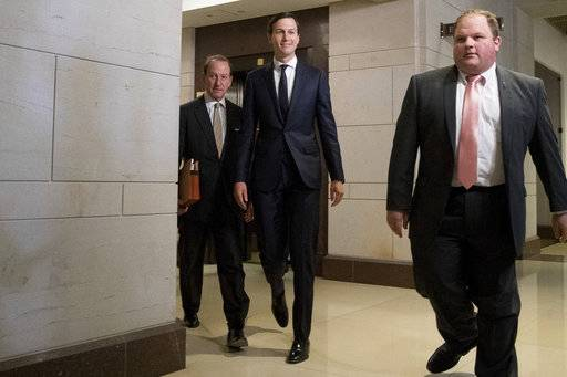 White House senior adviser Jared Kushner, second from right, accompanied by his attorney Abbe Lowell, left, arrives on Capitol Hill in Washington, Tuesday, July 25, 2017, to meet behind closed doors before the House Intelligence Committee on the investigation into possible collusion between Russian officials and the Trump campaign.