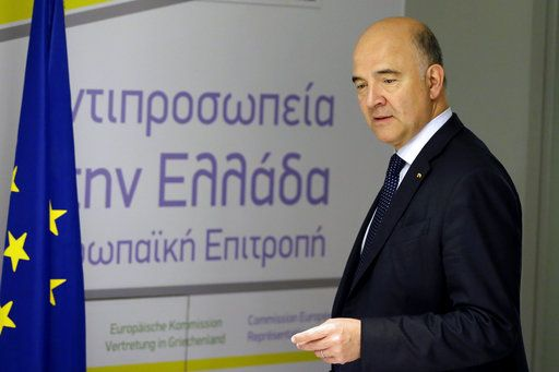 European Commissioner for Economy Pierre Moscovici arrives for a news conference in Athens, Tuesday, July 25, 2017. Greece is poised to tap international bond markets for the first time in three years in a move the government hopes will signal the country is ready to emerge from its bailout era.